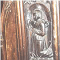 Carving of 16th C vicar in St Edmund's choir stalls