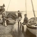 Carrying sprats ashore - early 1900s