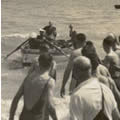 King George V1 being rowed ashore to visit the Duke of York Camp on Southwold Common in 1938