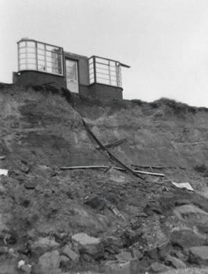 Last wall of a house at Easton Bavents about to succumb to the sea in 1967