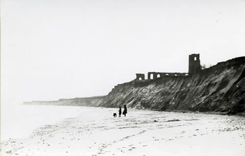 All Saints Church, Dunwich, photographed in 1904 after it had just started falling into the sea